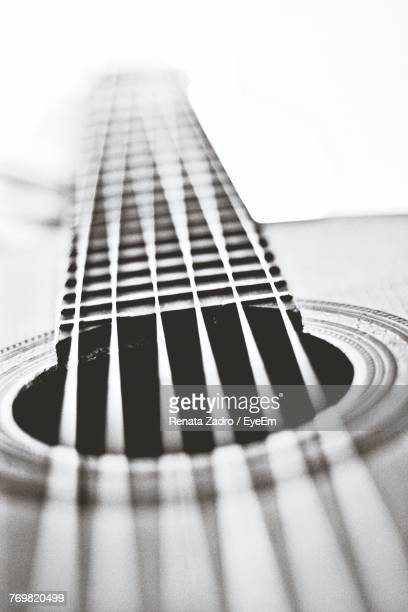 close-up of guitar - acoustic guitar stock pictures, royalty-free photos & images
