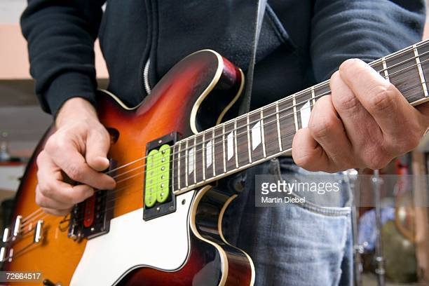 close-up of guitarist playing guitar - martin guitar stock photos and pictures