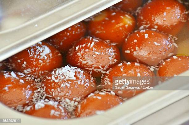 Close-Up Of Gulab Jamuns In Container