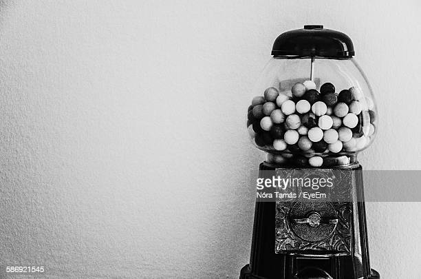 Close-Up Of Gumball Machine Against Wall