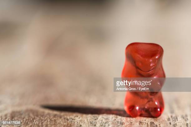 Close-Up Of Gummi Bear On Wooden Table