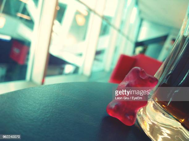 Close-Up Of Gummy Bear By Drink On Table