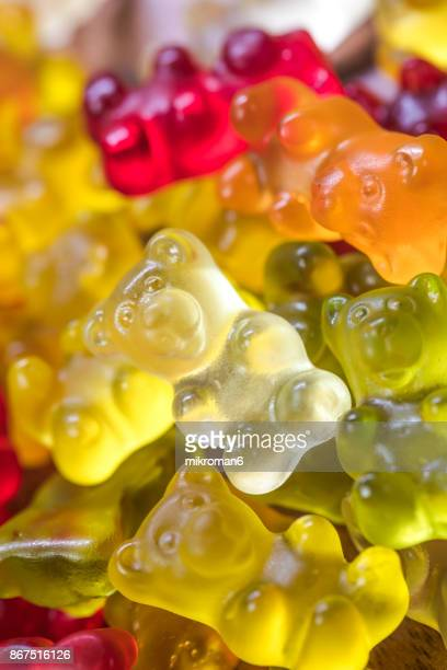 close-up of gummy bears candies - gummi bears stock photos and pictures