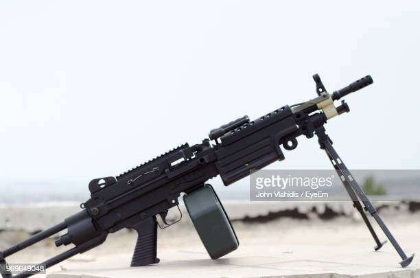 close-up of gun against sky - machine gun stock pictures, royalty-free photos & images