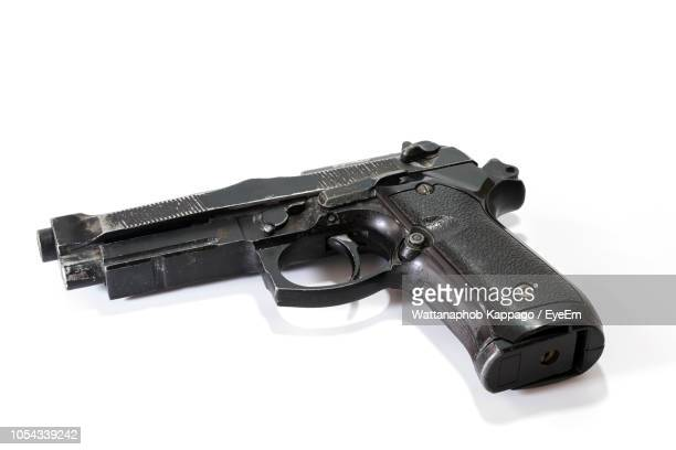 close-up of gun against white background - handgun stock pictures, royalty-free photos & images