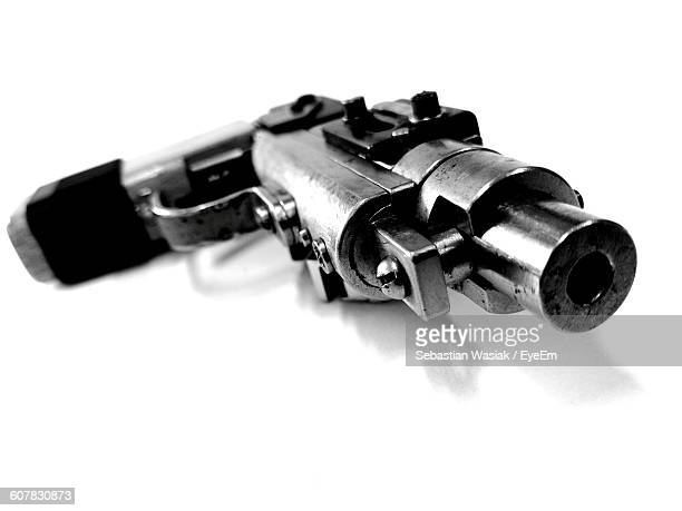 Close-Up Of Gun Against White Background