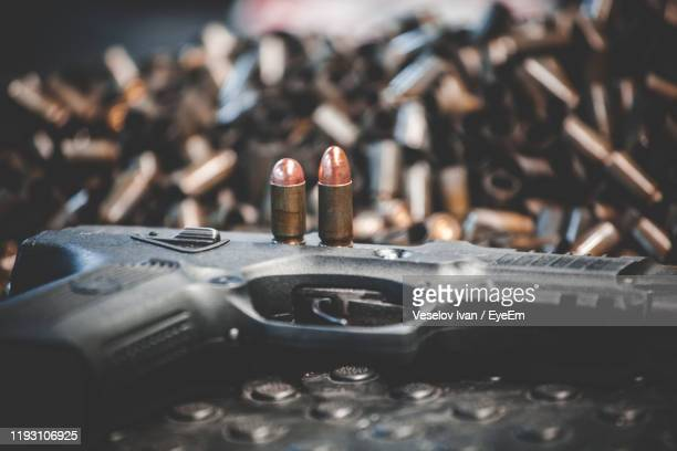 close-up of gun on table - ammunition stock pictures, royalty-free photos & images