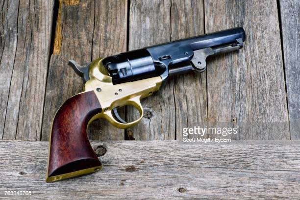 Close-Up Of Gun On Wooden Table