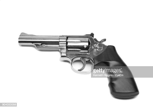 Close-Up Of Gun Over White Background