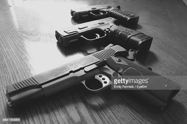 close-up of guns on table - armi foto e immagini stock