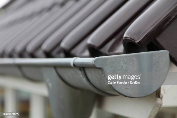 close-up of gutter on roof - roof gutter stock photos and pictures
