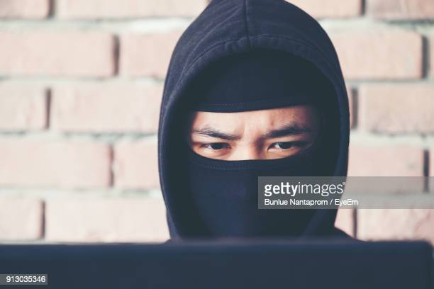 Close-Up Of Hacker Wearing Mask