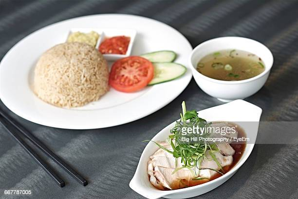 Close-Up Of Hainanese Chicken Rice Served On Table