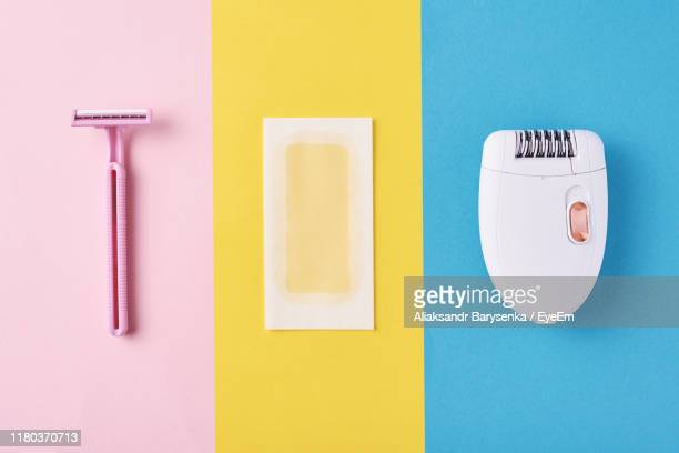 close-up of hair removal equipment on colored background - wax stock pictures, royalty-free photos & images