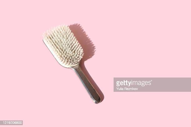 close-up of hairbrush on the pink background - hairbrush stock pictures, royalty-free photos & images