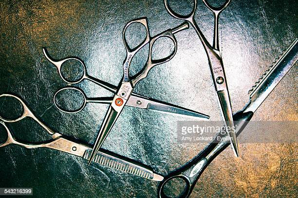 Close-Up Of Haircutting Scissors On Table