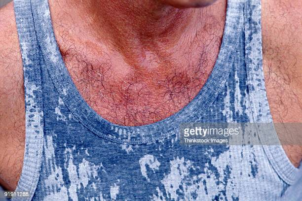close-up of hairy chest in wet tank top - hairy man chest stock photos and pictures