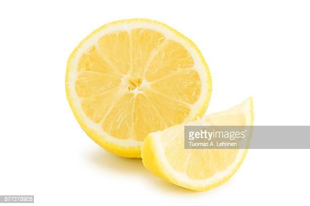 Closeup of half and quarter slices of lemon