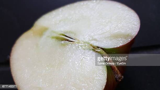 Close-Up Of Halved Apple On Table