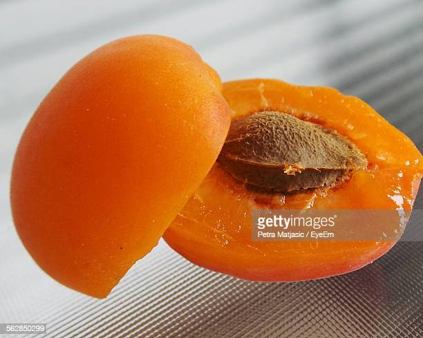 Close-Up Of Halved Apricots On Glass