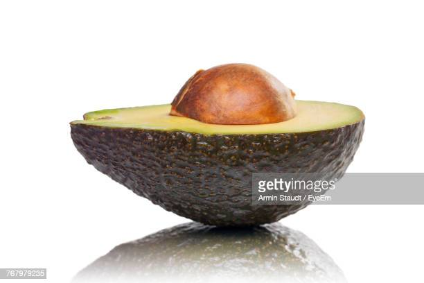 Close-Up Of Halved Avocado Against White Background
