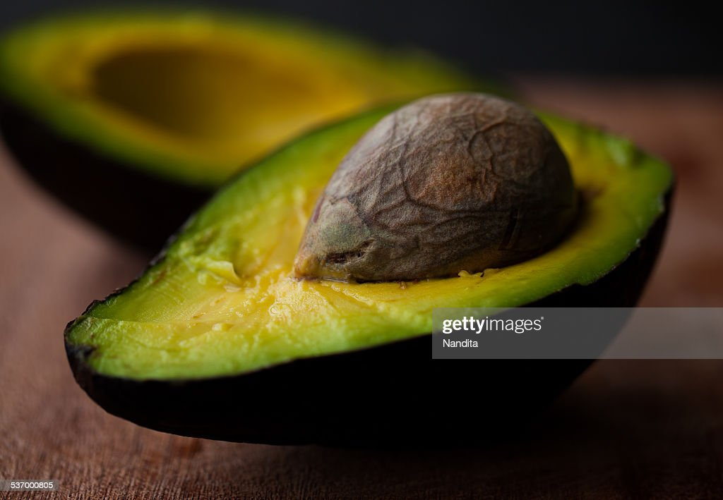 Close-up of halved avocado fruit : Stock Photo