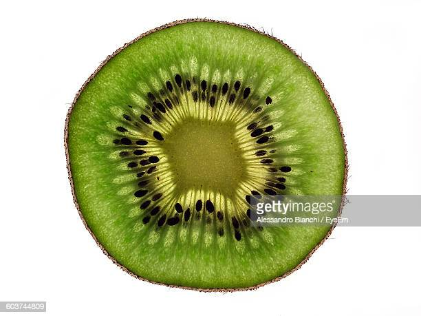 Close-Up Of Halved Kiwi Against White Background