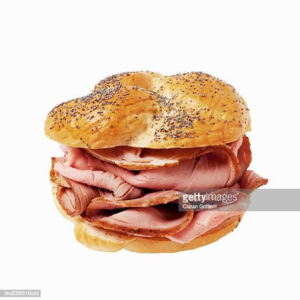 Close-up of ham on Kaiser roll