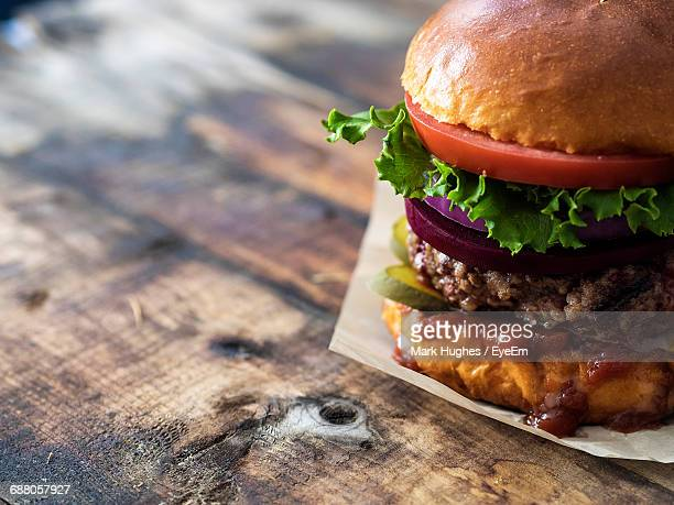 close-up of hamburger on table - hamburger stock pictures, royalty-free photos & images