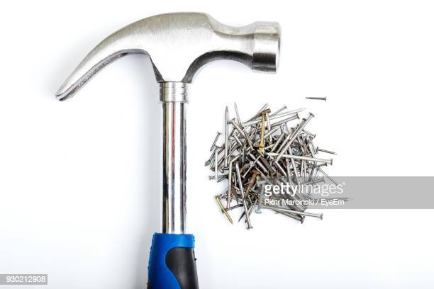 close-up of hammer and nails over white background - hammer stock pictures, royalty-free photos & images