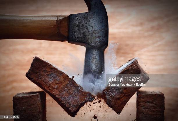 close-up of hammer hitting bricks - hammer stock pictures, royalty-free photos & images