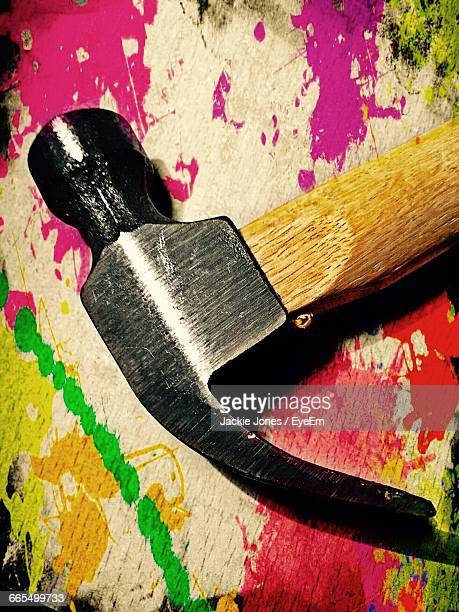 close-up of hammer on colorful table - jackie hammers stock pictures, royalty-free photos & images