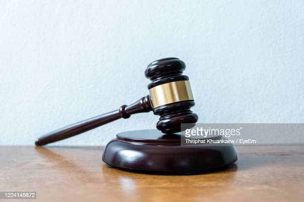 close-up of hammer on table - lawsuit stock pictures, royalty-free photos & images
