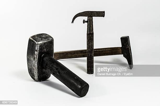 Close-Up Of Hammers Against White Background