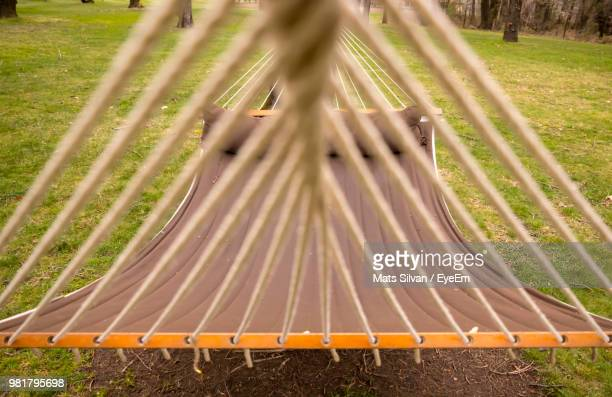 Close-Up Of Hammock Hanging Over Field At Park
