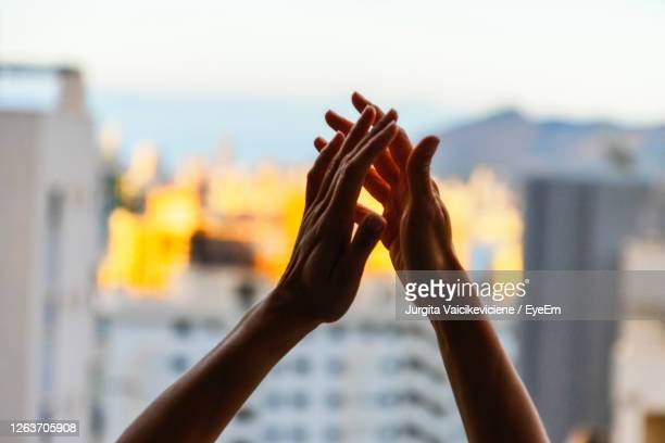 close-up of hand against blurred background - 手をたたく ストックフォトと画像