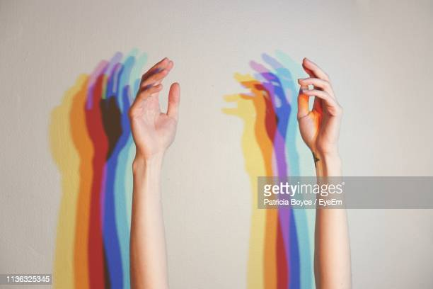close-up of hand against white background - human gender stock pictures, royalty-free photos & images