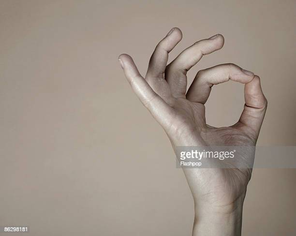Close-up of hand doing okay sign