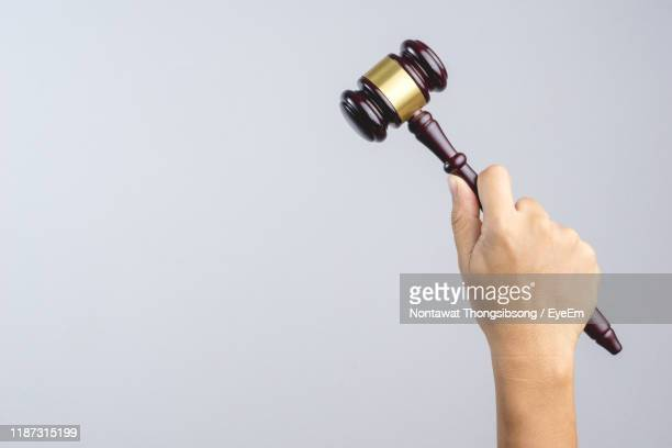 close-up of hand gavel against gray background - auction stock pictures, royalty-free photos & images