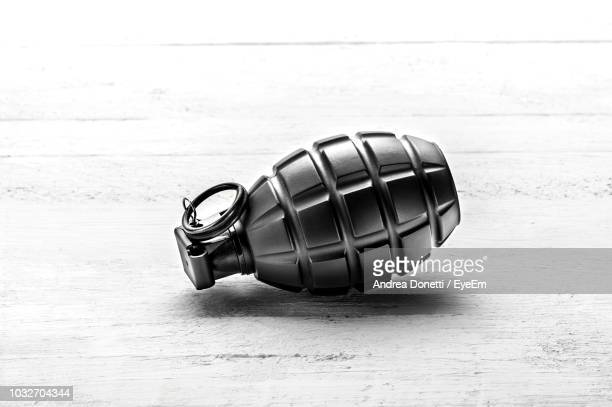 close-up of hand grenade on table - explosive material ストックフォトと画像