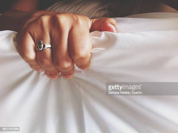 close-up of hand gripping white fabric - grab stock pictures, royalty-free photos & images
