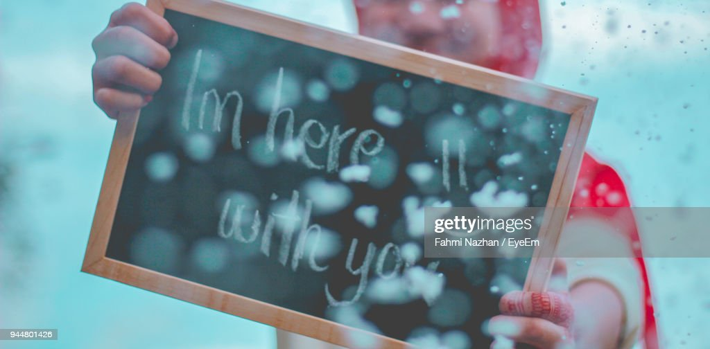 Close-Up Of Hand Holding Blackboard With Text : Stock Photo