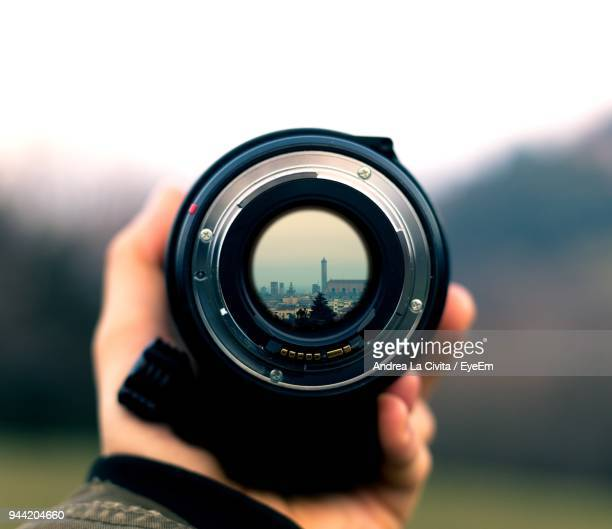 close-up of hand holding camera - image focus technique stock pictures, royalty-free photos & images
