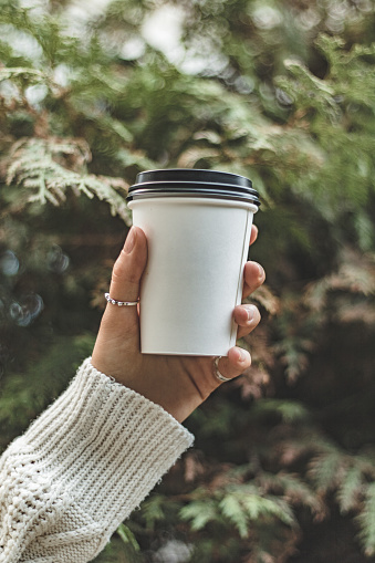 Close-Up Of Hand Holding Disposable Cup - gettyimageskorea