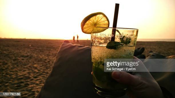 close-up of hand holding drink - scheveningen stock pictures, royalty-free photos & images
