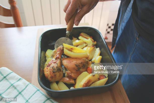 Close-Up Of Hand Holding Food In Bowl