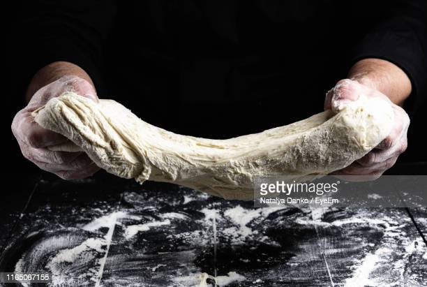 close-up of hand holding ice cream on table - dough stock pictures, royalty-free photos & images