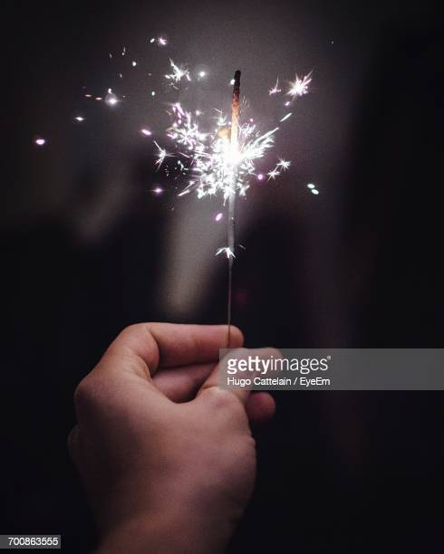 Close-Up Of Hand Holding Illuminated Sparkler