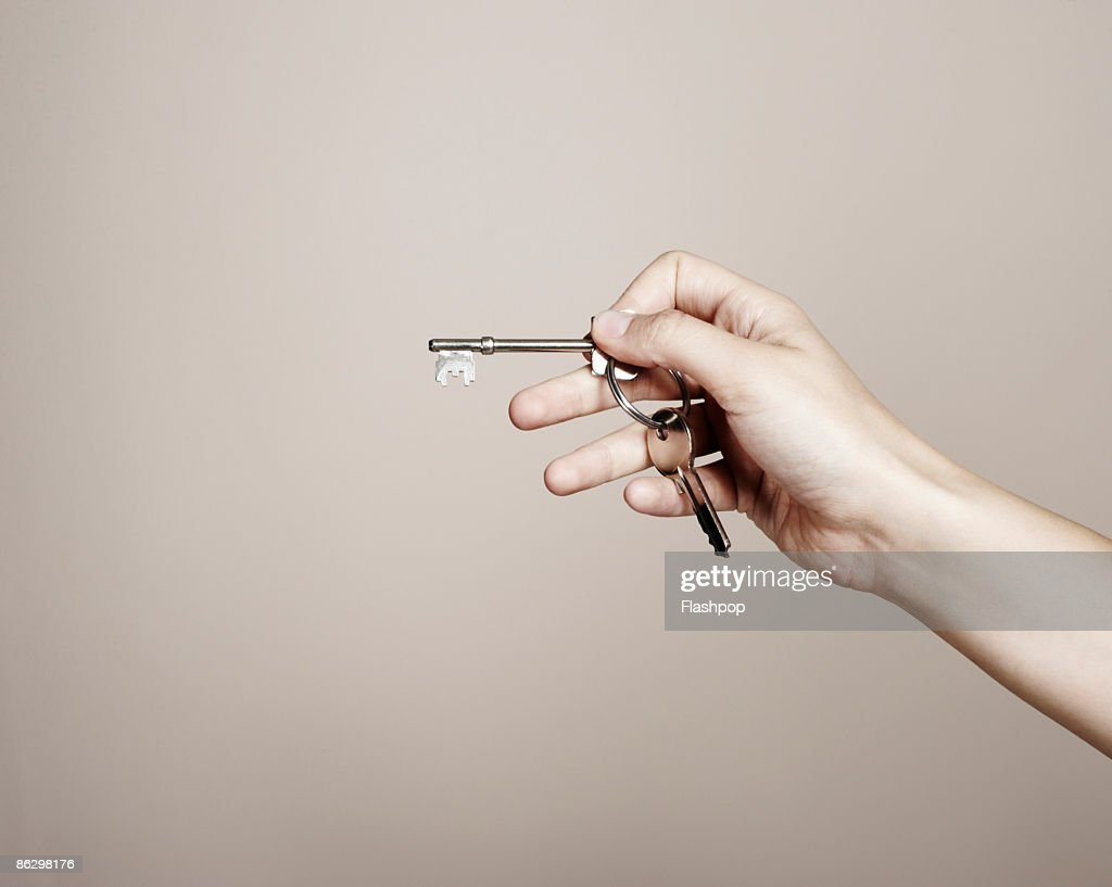 Close-up of hand holding keys : Stock Photo