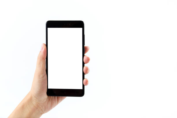 close-up of hand holding mobile phone against white background - human hand stock pictures, royalty-free photos & images